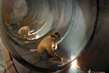 Fototapete - welding of seams of steel capacity