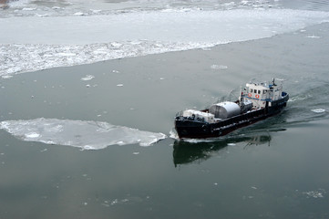 the small vessel floats on the river don among ices