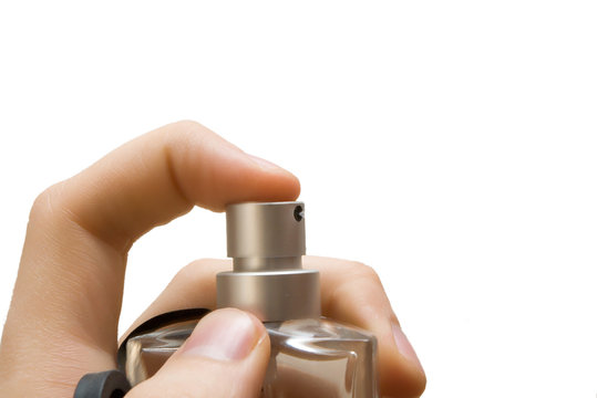 hand with perfume bottle