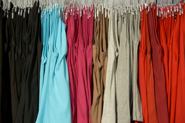 rack of clothes with a variety of colours