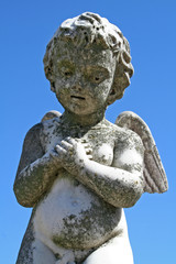 child angel statue against blue sky