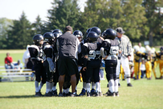 coach in football huddle