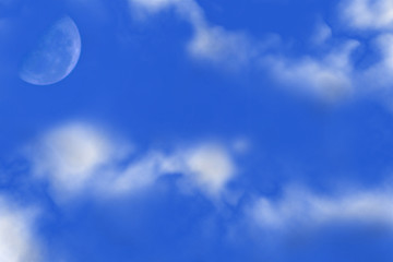 half moon and white clouds
