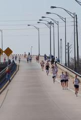 runners down the bridge