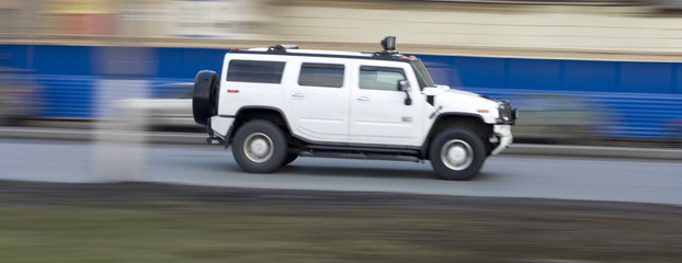 hummer suv car driving fast, rushing forward