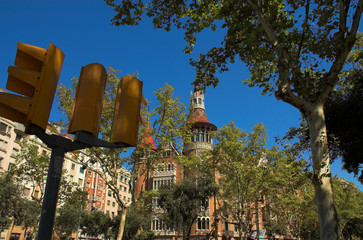 house with spires in barcelona city and traffic lights