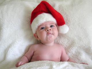 funny baby face in santa hat