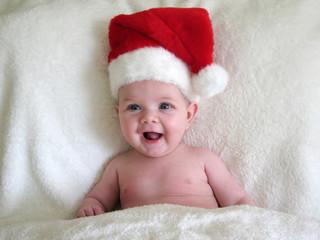 happy baby wearing santa hat