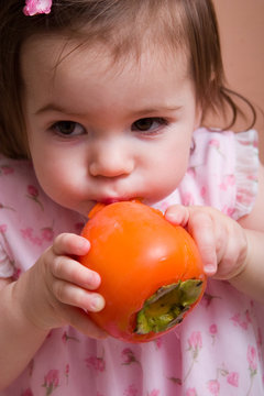 girl with persimmon