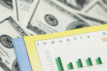 business concept - bar charts and dollar bank notes