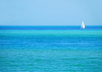 sailboat on turquoise sea