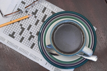 cup od coffee and crosword puzzle