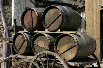 vintage carriage loaded with wooden barrels
