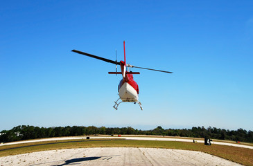 rear view of helicopter taking off