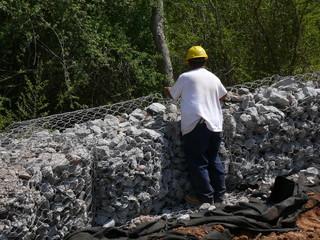 man working on rock wall