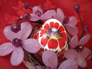 beautiful easter egg and flower on red