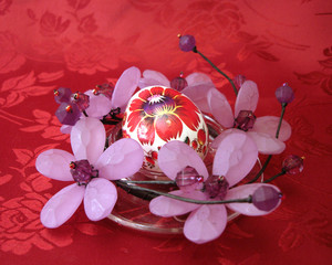 easter egg with flowers on red background