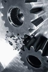 three gears against steel