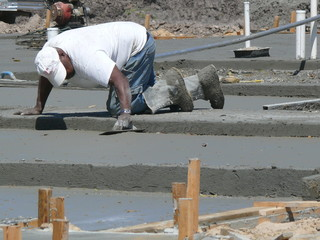 man finishing concrete