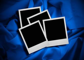 photo frames against textile background