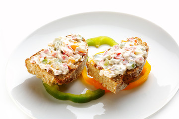 bread with cheese cream and vegetables