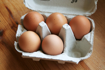 box of eggs with one missing