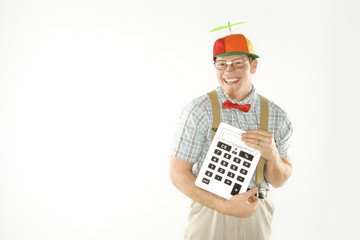 young man dressed like nerd holding large calculator.