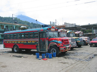 old shool bus  in the road station, guatemala