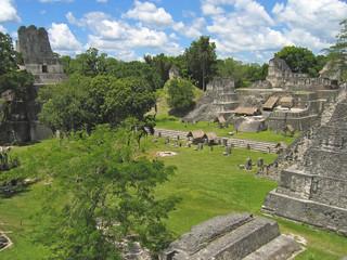 plaza of old maya ruins in the jungle, tikal, guatemala