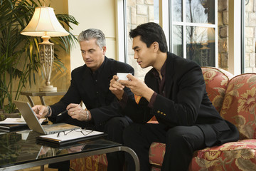 two businessmen at hotel.