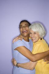 women embracing.
