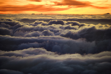 Sunrise over clouds in Haleakala, Maui, Hawaii.