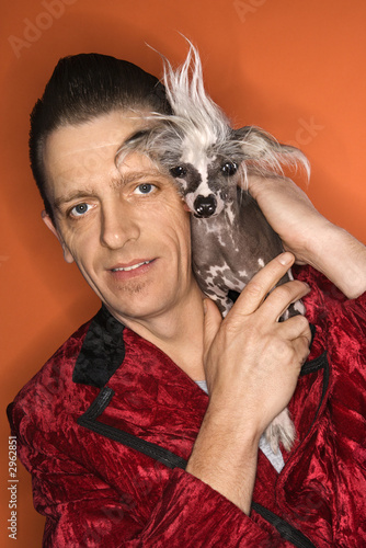 Man Holding Chinese Crested Dog Stock Photo And Royalty Free