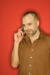 Caucasian man talking on cellphone.