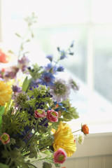 Flower arrangement in front of window.