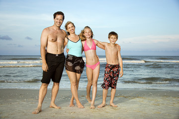 Portrait of family at beach.