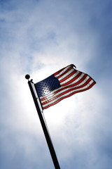 American flag blowing in breeze.
