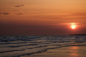 Sun setting over beach on Bald Head Island, North Carolina.