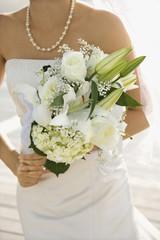 Bride holding bouquet.
