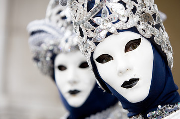 two venetians in blue and silver costumes