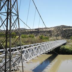 suspension bridge over river in utah.