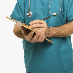 doctor taking notes on a patient's chart.