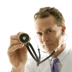 doctor holding out stethoscope.