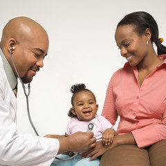 mother holding baby for pediatrician to examine.