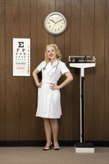 female nurse standing in retro setting.