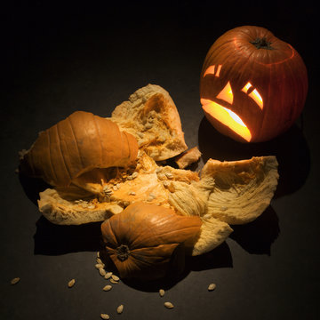 jack-o'-lantern with smashed pumpkin.