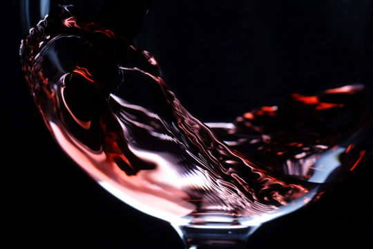 closeup of red wine pouring