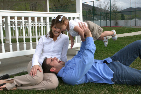 young family on grass ii