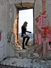 girl in destroyed window opening