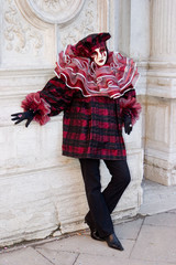a red and black venetian costume